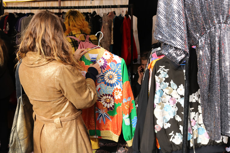Customer browsing vintage clothing at Flea at Vinegar Yard
